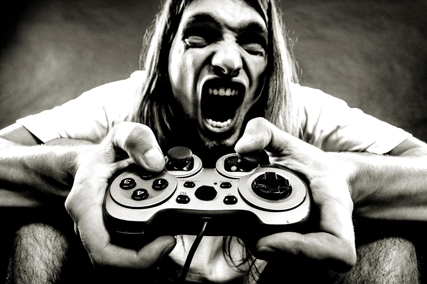 Un jeune homme jouant à un jeu vidéo violent